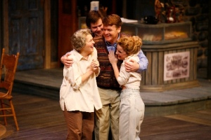 """Carol Schultz, Casey Predovic, John Scherer and Winslow Corbett share a break-through moment in """"The Foreigner"""" at the Rep. Photo courtesy of the Repertory Theatre of St. Louis."""