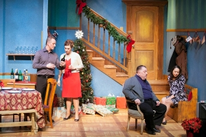 "Eric Dean White as Neville and Emily Baker as Belinda discuss issues as Jason Grubbe as Harvey enjoys a ""shoot-'em-up"" holiday story on TV as St. Louis Actors' Studio presents ""Season's Greetings."" Photo: John Lamb."