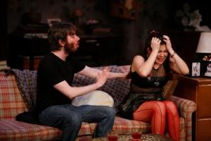 "Dan McCabe (as Leo) tries to calm down Lisa Helmi Johanson (Amanda) in ""4000 Miles"" at the Rep Studio. Photo courtesy of the Repertory Theatre of St. Louis."