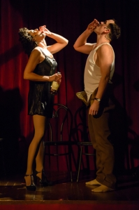 """Gia Grazia Valenti and Justin Ivan Brown share a drink during an interlude in """"Cafe Chanson"""" at Upstream Theatre. Photo: Peter Wochniak"""