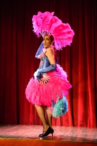 """Antonio Rodriguez performs his """"fan dance"""" during """"Cafe Chanson"""" at Upstream Theatre. Photo: Peter Wochniak"""