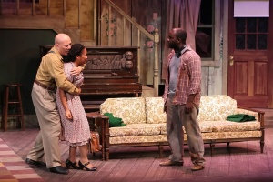 """Bob Mitchell tries to hold back Sharisa Whatley from attacking Ronald L. Conner in """"The Piano Lesson"""" at the Black Rep. Photo: Stewart Goldstein"""