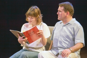 "Sigrid Sutter as Karen and Christopher Hickey as Bobby discuss a script in ""Speed-the-Plow"" at New Jewish Theatre. Photo: John Lamb"