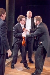 "Stephen Peirick, John Wolbers, Jonathan Hey and Dennis L. Fowarczny II have an argument after their White House engagement in ""Opus"" at WEPG. Photo: John Lamb"