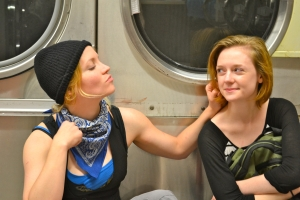 "Rachel Hanks and Amanda Swearingen share a moment- or do they?- in ""There's A Gun In Your Goodbye Bag"" at OnSite Theatre's production in a laundromat."