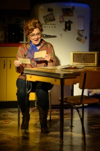 "Zoe Vonder Haar as Louise reads a letter from Patsy in Stages' production of ""Always...Patsy Cline."" Photo: Peter Wochniak"