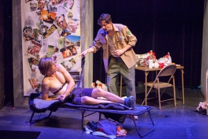 "Paul Cooper cowers before park ranger David Wassilak in ""Blood Brothers."" Photo: John Lamb"