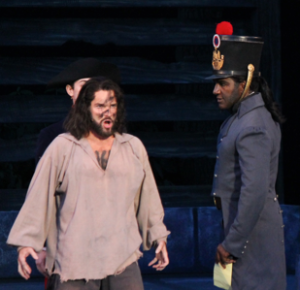 "Hugh Panaro as Valjean and Norm Lewis as Javert in ""Les Miserables"" this week at the Muny."