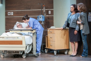 "Julie Layton as the nurse attends to Bobby Miller as Ben while Judi Mann and Meghan Maguire look on in ""The Lyons"" at Max & Louie. Photo: John Lamb"