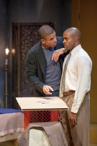 "Reginald Pierre as Lincoln tries to explain the finer parts of three card monte to his brother Booth (Chauncy Thomas) in ""Topdog/Underdog"" at STLAS. Photo: John Lamb"