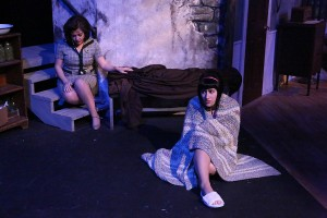 """Sarah Porter and Marcy Wiegert contemplate their fate in the basement during New Line's production of """"Night Of The Living Dead."""" Photo: Jill Ritter Lindberg"""