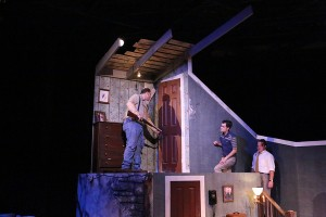 "Zachary Allen Farmer, Joseph McAnulty and Mike Dowdy explore the upper story in ""Night Of The Living Dead"" at New Line. Photo: Jill Ritter Lindberg"