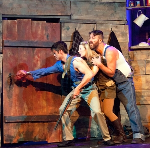 """Paul Cereghino, Brittany Kohl and Zachary Stefaniak ponder what's lurking on the other side of the door in Stray Dog's """"Evil Dead-The Musical."""" Photo: John Lamb"""