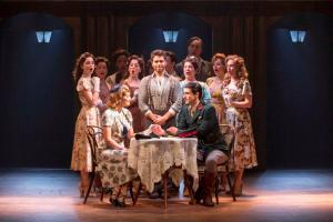 "Caroline Bowman as Eva and Sean MacLaughlin as Peron (seated) as Josh Young as Che and the chorus surround them in ""Evita"" at the Fox. Photo: Richard Termine"