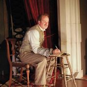 "B. Weller at a stool-turned-writing desk in ""The Woman In Black"" at SATE. Photo: Joey Rumpell"