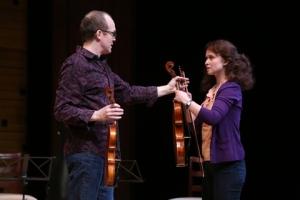 "James Joseph O'Neil as Eliot hands the rare Lazara viola to Rachael Jenison as Grace in the Rep's ""Opus."" Photo: Jerry Naunhem, Jr."