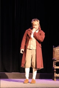 "William-Henry Ireland (Joe Hanrahan) takes a signature sniff at his kerchief in ""Solemn Mockeries."""