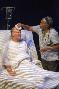 "Fannie Lebby soothes the forehead of John Pierson in ""The Ride Down Mount Morgan"" at STLAS. Photo: John Lamb"