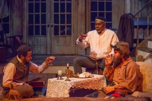"Gregory Fenner, J. Samuel Davis and Austin Pierce celebrate their improvised Seder meal at the New Jewish Theatre production of ""The Whipping Man."" Photo: John Lamb"