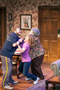 "Michelle Hand as Tami tries to get between Daniel Lanier as Josh and Carmen Russell as Sue in ""Falling"" at Mustard Seed Theatre. Photo: John Lamb"