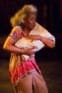 "Maymay clutches the ""Windmill Baby"" at Upstream Theatre. Photo: John Lamb"