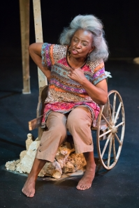 "Linda Kennedy as Maymay portraying Wunman during ""Windmill Baby"" at Upstream Theatre. Photo: John Lamb"