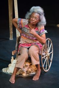 """Linda Kennedy as Maymay portraying Wunman during """"Windmill Baby"""" at Upstream Theatre. Photo: John Lamb"""