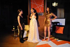 "Cara Barresi, Wendy Renee Greenwood and Ellie Schwetye contemplate the infamous wedding dress in ""Bachelorette"" at SATE. Photo: Joey Rumpell"