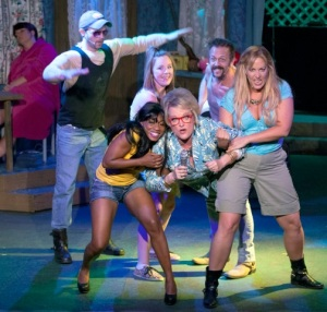 "Kim Furlow is hoisted by cast members during a dream sequence/Sally Jessy Raphael show in ""The Great American Trailer Park Musical"" at Dramatic License. Photo: John Lamb"