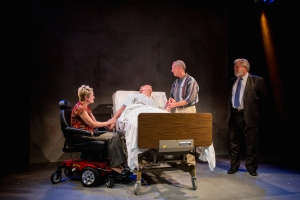 "Lavonne Byers, John Flack and Greg Johnston surround the hospital bed of Eric Dean White in ""The Normal Heart"" at Hot City Theatre. Photo: Todd Studios"