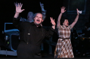 "Zak Farmer leads the congregation in ""Bonnie & Clyde"" at New Line Theatre. Photo: Jill Ritter Lindberg"