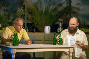 "Matt Hanify and John Foughty share several beers in ""Off The Map"" at West End Players Guild. Photo: John Lamb"