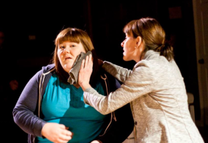 """Katie Donnelly and Ann Marie Mohr have one of their few mother-daughter bonding moments in R-S Theatrics' """"Eat Your Heart Out."""" Photo: Michael Young"""