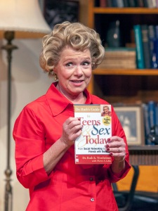 """Susie Wall's Dr. Ruth holds one of the many, many books she's written on the subject over the years in """"Becoming Dr. Ruth"""" at New Jewish Theatre. Photo: John Lamb"""