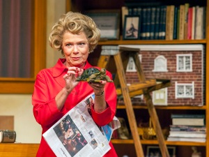"Another object to pack brings back stories from her past for Dr. Ruth as portrayed by Susie Wall at NJT's ""Becoming Dr. Ruth."" Photo: John Lamb"