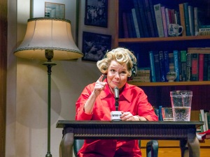 """Dr. Ruth- portrayed by Susie Wall- talks sex on one of her radio broadcasts in """"Becoming Dr. Ruth"""" at New Jewish Theatre. Photo: John Lamb"""