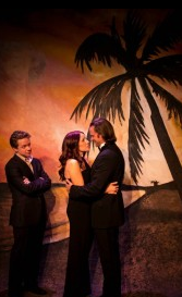 "Producer Ben Nordstrom looks on as Maggie Conroy and Tyler Vickers pledge their love in the opening scene of ""Reality"" at HotCity Theatre. Photo: Kyra Bishop"