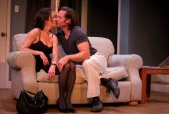 "Julie Layton and Tyler Vickers get cozy after things go sour in ""Reality"" at HotCity Theatre. Photo: Kyra Bishop"