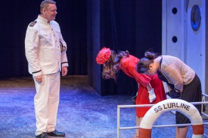 "Mother and daughter respectfully bow to the ship's captain in ""White To Gray"" at Mustard Seed Theatre. Photo: John Lamb"