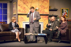 "Stephen Peirick shouts into the phone as Michelle Hand, Michael Juncal and Sarajane Alverson can only sit and wait in Stray Dog's ""God Of Carnage."" Photo: John Lamb"