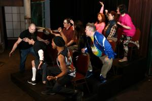 "Matt Hill tries to control and unruly crowd in ""Jerry Springer- The Opera"" at New Line. Photo: Jill Ritter Lindberg"