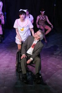 "Taylor Pietz as Baby Jane helps a wounded (dead?) Jerry Springer as he heads to purgatory in ""Jerry Springer- The Opera."" Photo: Jill Ritter Lindberg"