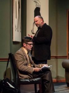 "Nathan Bush (seated) endures the wrath of John Pierson in ""Seminar"" at STLAS."