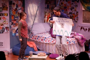 "Reynaldo Piniella as Anthony shows his pathetic poster to Danielle Carlacci as Caroline in ""I And You"" at the Rep Studio. Photo by Jerry Naunheim, Jr.TUESDAY, OCT. 27, 2015 - This is the Repertory Theatre of St. Louis' production of ""I and You"" at the Loretto-Hilton Center. ©Photo by Jerry Naunheim Jr."